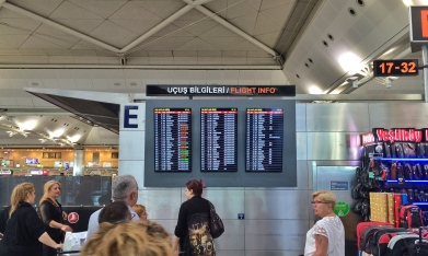 The flight board at the departures entrance, where one of the bombs exploded.